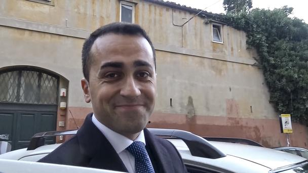 5-Star Movement Leader Luigi Di Maio speaks to reporters as he leaves home in Rome (Ansa/AP)
