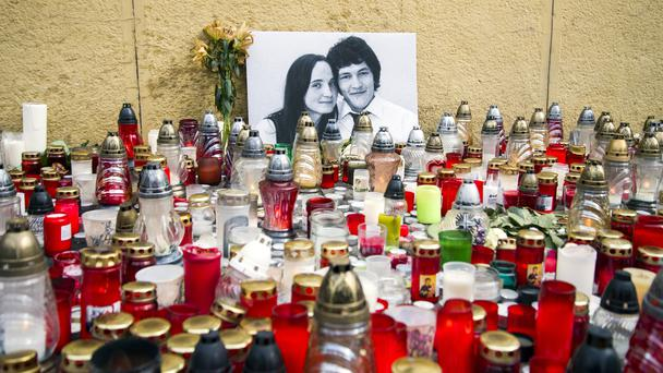 Candles left in tribute to murdered Slovakian investigative reporter Jan Kuciak and his fiancee Martina (Jakub Kotian/TASR via AP)