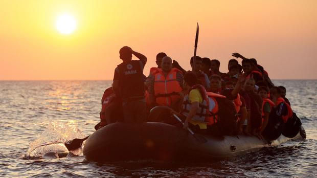 21 migrants were missing and probably drowned after a rubber dinghy and a wooden boat set off from Libya for Italy and had to be rescued, the International Organisation for Migration (IOM) said yesterday (stock picture)