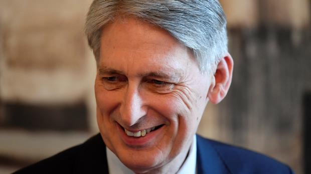 Chancellor Philip Hammond will reject the arguments of 'sceptics' in his keynote speech (Toby Melville/PA)