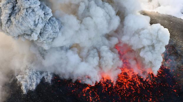 A column of volcanic smoke rises from the crater on the Shinmoedake volcano (Kyodo News via AP)