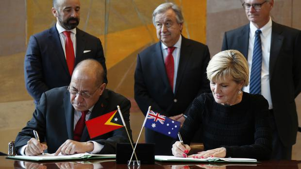 East Timorese minister of state Agio Pereira and Australian foreign minister Julie Bishop sign a treaty during a ceremony at United Nations headquarters (Seth Wenig/AP)