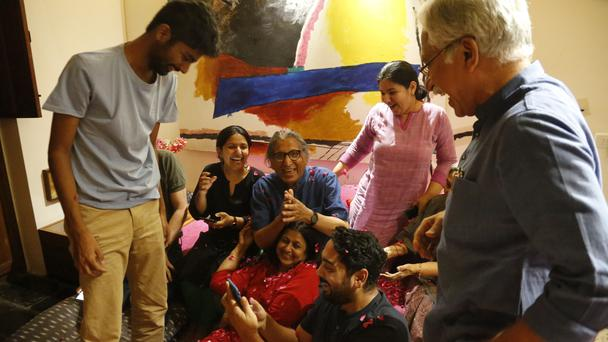 India's Balkrishna Doshi, centre in blue, who won the 2018 Pritzker Architecture Prize celebrates with family members at his home in Ahmadabad, India (Ajit Solanki/AP)