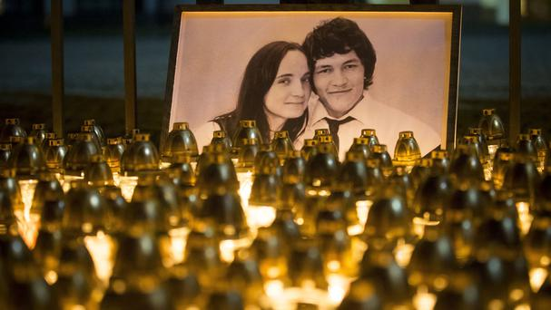 Light tributes placed during a silent protest in memory of murdered journalist Jan Kuciak and his fiancee Martina Kusnirova (Bundas Engler/AP)