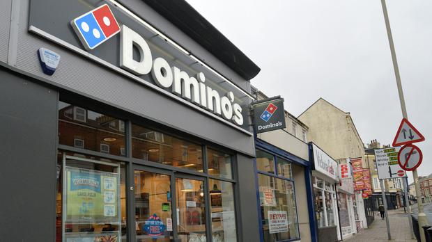 Domino's is benefiting from the decline in people eating out (Anna Gowthorpe/PA)