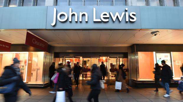 John Lewis has reported falling annual profits (Charlotte Ball/PA)