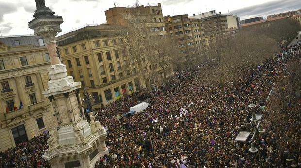 Thousands of demonstrators protest against male violence during the female general strike to commemorate International Women's Day, in Pamplona, northern Spain (Alvaro Barrientos/AP)