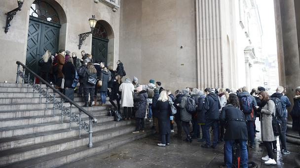 Members of the media queue up in front of the courthouse (Mads Claus Rasmussen/Ritzau via AP)