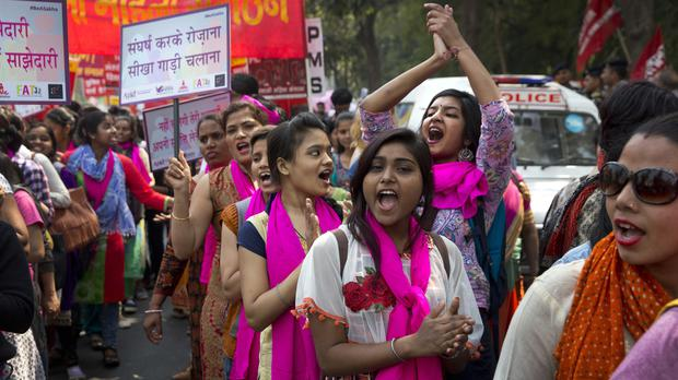 Indian women sing and dance during a march to celebrate International Women's Day in New Delhi (Manish Swarup/AP)