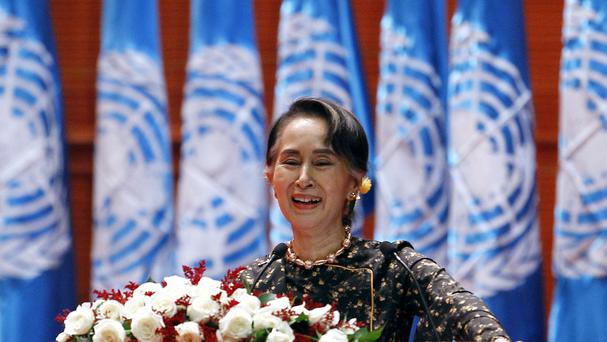 Burma's leader Aung San Suu Kyi delivers a speech during a ceremony to mark International Women's Day (Aung Shine Oo/AP)