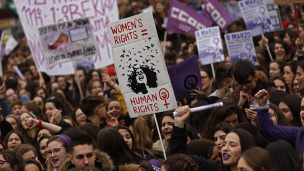 Women shout slogans during a protest at the Sol square during the International Women's Day in Madrid (Francisco Seco/AP)