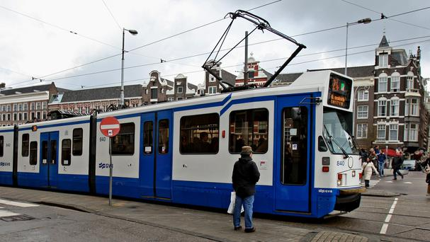 A tram in the centre of Amsterdam (Chris Radburn/PA)