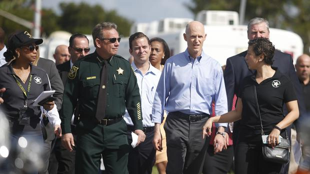 Rick Scott said the bill, written since the shooting, balances 'our individual rights with need for public safety' (Wilfredo Lee/AP)