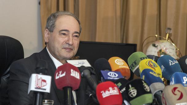 Syrian deputy foreign minister Faisal Mekdad speaks during a news conference in Damascus (SANA/AP)