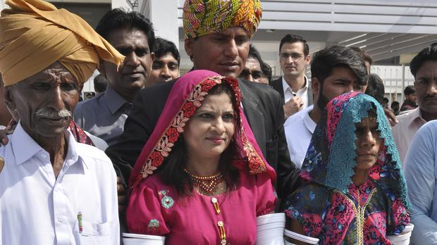 Krishna Kumari, centre, newly elected senator of the Pakistani Hindu Community, arrives at the Parliament (B.K. Bangash/AP)
