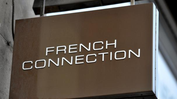 Retailer French Connection has said it is 'very close' to returning to profit, but continues to shut stores (Nick Ansell/PA)