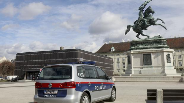 A police car in front of Austrian parliament in Vienna after an attack (AP Photo/Ronald Zak)