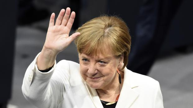 Angela Merkel waves as Germany's parliament met to elect her for a fourth term as chancellor (Gregor Fischer/dpa via AP)