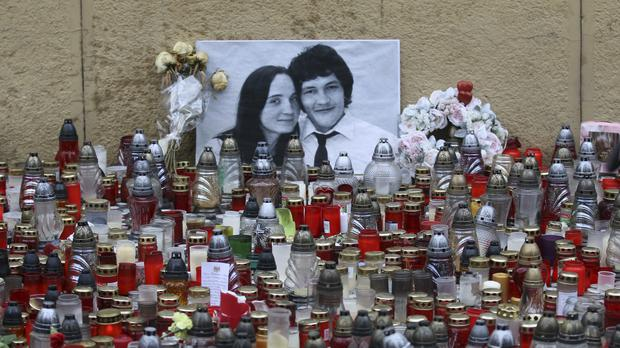 Candles are placed in front of a photo of journalist Jan Kuciak and his fiancee Martina Kusnirova during an anti-government rally in Bratislava, Slovakia (Ronald Zak/AP)