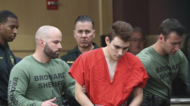 Nikolas Cruz is led into the courtroom before being arraigned (Amy Beth Bennett/AP)