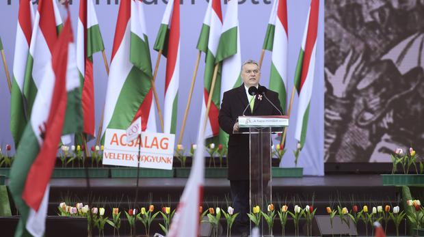 Viktor Orban arrives on the stage to address the crowd celebrating the 170th anniversary of the outbreak of the 1848 revolution (Tamas Kovacs/MTI via AP)