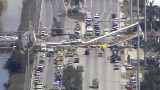 Emergency personnel work at the scene of a collapsed bridge in the Miami area (WPLG-TV via AP)