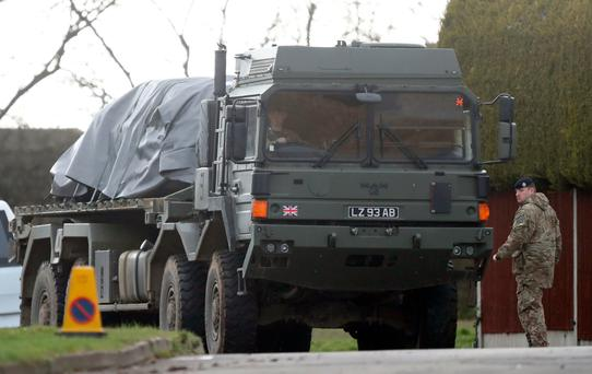 The car of Det Sgt Nick Bailey is removed on the back of an army lowloader at his home in Dorset. Photo: PA