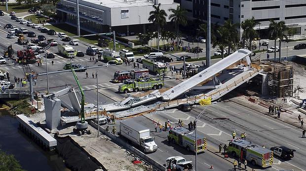 Emergency personnel at the scene in Miami (Pedro Portal/Miami Herald via AP)