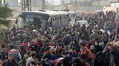 Syrian civilians flee the fighting in eastern Ghouta (Sana/AP)