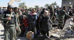 Civilians flee the fighting (Sana/AP)