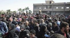 Syrian civilians flee the fighting (Sana/AP)