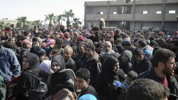 Syrian civilians flee from fighting between government forces and rebels in eastern Ghouta (SANA/AP)