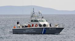 A coast guard vessel arrives at the port of Pythagorio on the eastern Greek island of Samos (Michael Svarnias/AP)