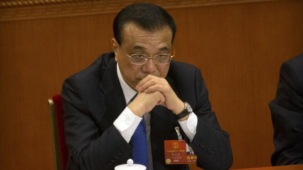 Li Keqiang has been re-appointed as the country's premier (AP Photo/Mark Schiefelbein)
