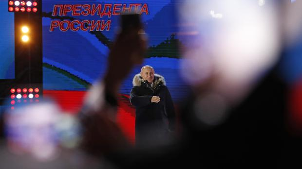 Vladimir Putin speaking to supporters in Moscow (Pavel Golovkin/AP)