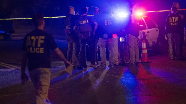 Authorities probe the scene of an explosion in south-west Austin, Texas (AP)