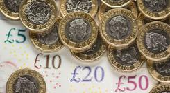 A picture of money, as official figures on inflation are published on Tuesday (PA)