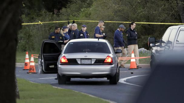 Officials work at the site of Sunday's explosion (AP)