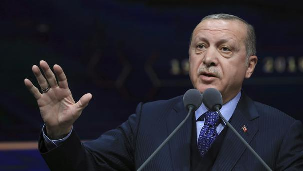 Mr Erdogan insists Turkish operations within Syria are aimed at removing terrorists (AP)