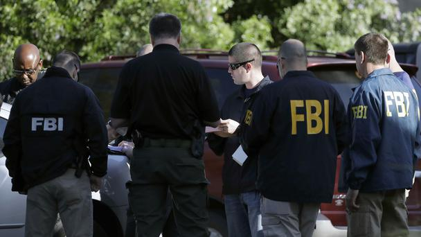 FBI agents near the site of an explosion in Austin, Texas (Eric Gay/AP)
