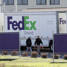 FBI agents at a FedEx distribution centre where a package exploded in Schertz, Texas (Eric Gay/AP)