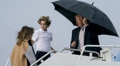 President Donald Trump, First Lady Melania Trump, and their son Barron (Andrew Harnik/AP)