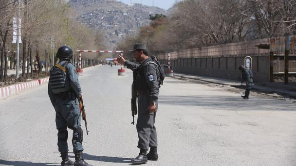 Police patrol the streets after a suicide attack in Kabul (Rahmat Gul/AP)