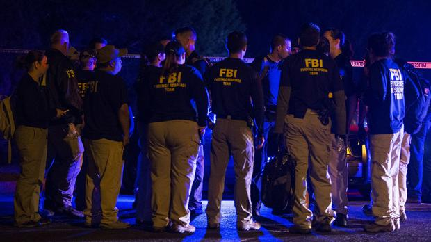 FBI agents meet at the scene of an explosion in Austin, Texas (Nick Wagner/Austin American-Statesman via AP)