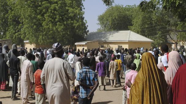 People gather outside the hospital where the kidnapped girls are being treated in Dapchi (Jossy Ola/AP)