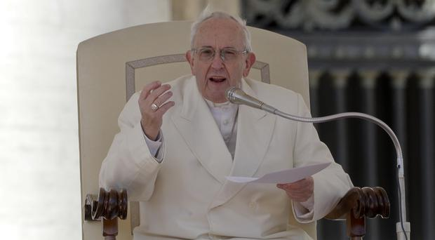 Pope Francis delivers his message during his weekly general audience in St Peter's Square (Andrew Medichini/AP)