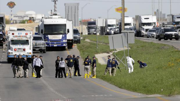 Officials at the scene where a suspect in a series of bombing attacks in Austin blew himself up (Eric Gay/AP)