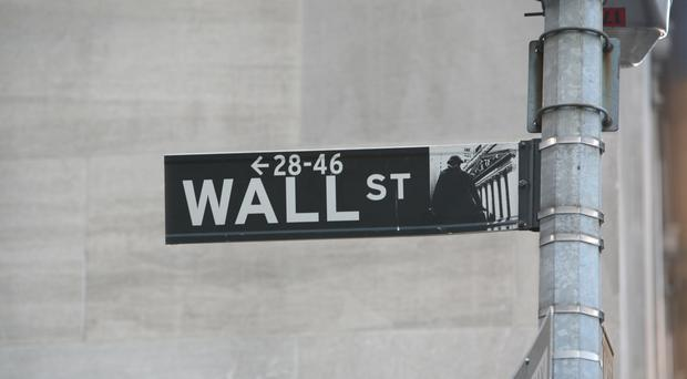 Stocks wobble and end lower after Fed raises interest rates