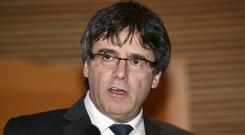 Carles Puigdemont is among those charged (Martti Kainulainen/Lehtikuva via AP)