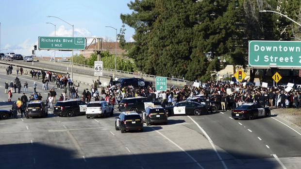 Demonstrators protesting over the fatal shooting of an unarmed black man shut down Interstate 5 in Sacramento, California (Robert Petersen/AP)
